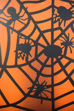 Small Black Spiders on Web on Orange Background Stock Photography