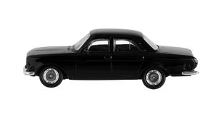 Small black toy car. Isolated on white background stock images