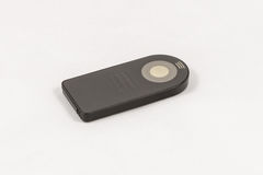 Small black unbranded remote control for DSLR camera. Isolated on a white background Stock Image