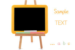 Small blackboard. On easel with chalk on white background with room for text Royalty Free Stock Images