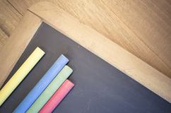 small blackboard with chalks close up Royalty Free Stock Images