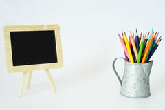 Small Blackboard and Color Pencils Stock Images