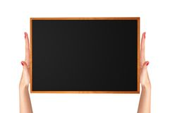 Small blackboard with wood frame in woman hands Stock Photography