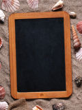 Small blank blackboard on the sand Stock Photography