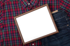 Small blank board with pant and shirt Stock Image