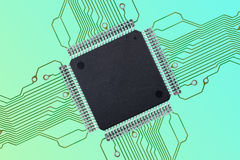 Small Blank Integrated Circuit with Connections on Colorful Background. Small, blank Thin Quad Flat Package  TQFP  Integrated Circuit  IC  with Printed Circuit Stock Image