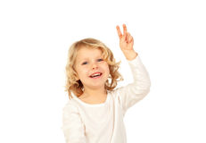 Small blond child doing victory sign with his fingers Royalty Free Stock Photography