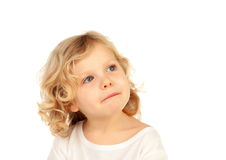 Small blond child imagining something Royalty Free Stock Images