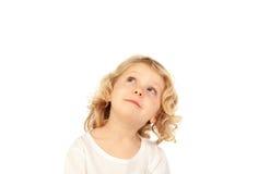 Small blond child imagining something Royalty Free Stock Photo