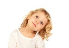 Small blond child imagining something Stock Photo