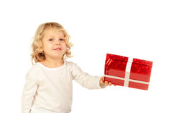 Small blond child with a red present Royalty Free Stock Images