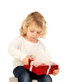 Small blond child with a red present Stock Photos