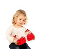 Small blond child with a red present Royalty Free Stock Image