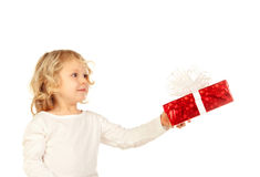 Small blond child with a red present Stock Images