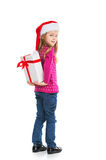 Small blond girl hiding big present behind back. Stock Images