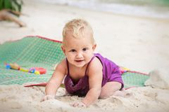Small blonde baby girl  crawling Royalty Free Stock Photography