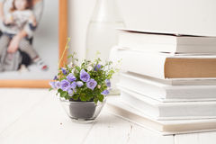 Small blooming flowers on a white wooden table Stock Image