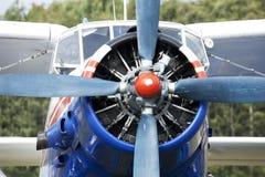 Small blue airplane under sky Stock Photos