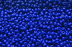 Small blue beads. Background of bright blue beads Royalty Free Stock Photos