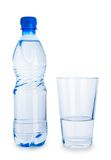 Small blue bottle and glass with water isolated Royalty Free Stock Photography