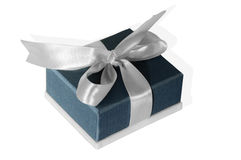 Small blue box tied with a silver ribbon.  Stock Image