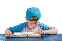 Small blue boy reading bible Royalty Free Stock Photos