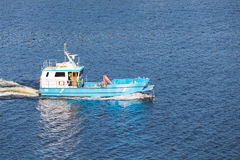Small blue cargo boat goes on Baltic Sea Royalty Free Stock Photo