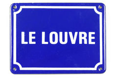 Small blue ceramic 'Le Louvre' sign Royalty Free Stock Photo