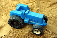Small blue children tractor toy Stock Photos