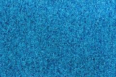Small Blue/Dark Blue Glitter. Macro photo of small blue/dark blue glitter Royalty Free Stock Photography
