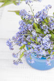 Small blue flowers in a jar Stock Images