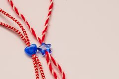 Small blue heart and star on red and white bakers twine with white background Royalty Free Stock Image