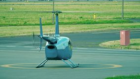 Small blue helicopter ready for take off from the airport stock video footage