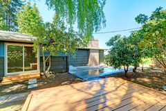 Small blue house with deck of the garden studio and birch tree. Royalty Free Stock Photography