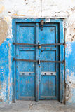 Small blue old closed  door to the house on the island of Zanzib Stock Photos