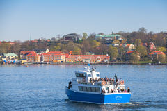 Small blue passenger ferry, Stockholm, Sweden Royalty Free Stock Images
