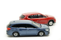 Small blue and red toy cars Stock Photos