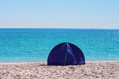 A Small Blue Shade Tent On A White Silica Sand Beach In Whitsundays Australia. A small blue round collapsible shade tent on the white silica sand of Whitehaven stock images
