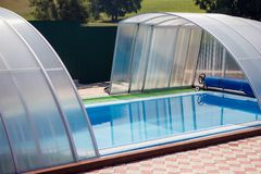 A small blue swimming pool with water under a canopy in the stre. A small swimming pool with water under a canopy in the street Royalty Free Stock Images