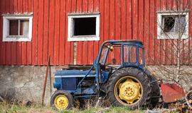 Small blue tractor in Norway Royalty Free Stock Images