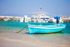 Small blue and white color fishing boat in port on island of Greece Royalty Free Stock Images