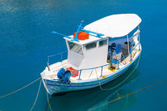 Small blue and white fishing boats. Royalty Free Stock Image