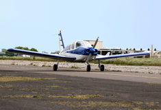 Small blue and white plane taking off Stock Photography