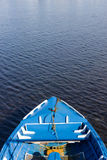 Small Blue Wooden Boat. A small blue wooden fishing boat in water Stock Images