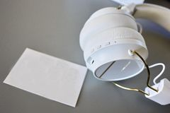 Small Bluetooth headphones, white color, close-up royalty free stock photo