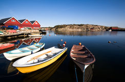 Small Boast at Dock. A group of small row boats tied to the dock royalty free stock photos