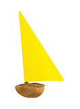 Small boat. Weak small boat made by walnut shell and paper sail Royalty Free Stock Photo