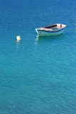 Small boat. A small boat on a turquoise mediterranean sea Stock Photo