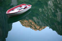 Small boat. Isolated small boat on a quiet lake Stock Photography