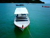 Small Boat. White small boat royalty free stock photo
